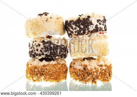 Stacked pastries isolated over white background