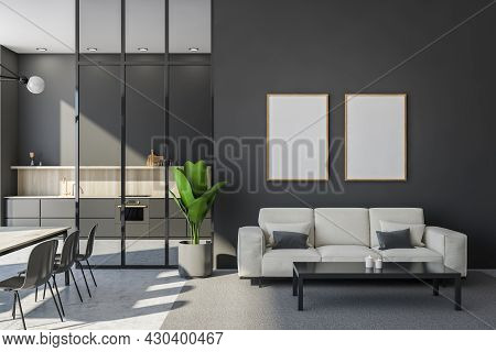 A Row Of Wood-framed Posters On A Grey Wall With A Seating Area Interior. Sofa, Coffee Table And A P