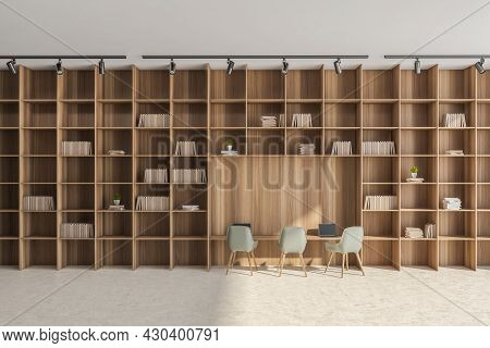 Design, Having Beige Flooring, Lights Above Floor-to-ceiling And Wall-to-wall Bookcase With A Desk N
