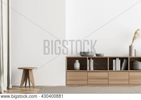 Plain Minimalist Light Beige Living Room Interior With Wooden Sideboard, Accent Stool Near Curtains,