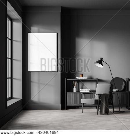 Banner On The Grey Wall Of The Dark Waiting Room Interior, Having Low Shelf, Armchair, Lamp, Window