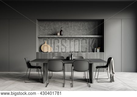 Dark Cozy Kitchen Room Interior With Dining Table, Six Chairs, Parquet Floor, Electric Cooker And Cr