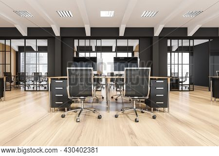 Black-and White Office Interior Of A Modern Company With Desk, Two Rolling Chairs, Sliding Glass Doo
