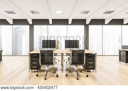 Panoramic Workspace Interior With Two Rolling Chairs At Either Side Of The Desk, Wooden Floor And Us