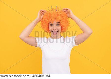Happy Egoistic Funny Girl With Fancy Look Wearing Orange Hair Wig And Princess Crown, Winner