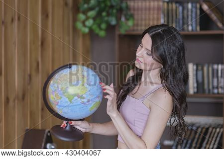 Portrait Of A Pretty Mixed-race Woman Hand Holding Earth Globe Model Ball Planning. Environmental Co