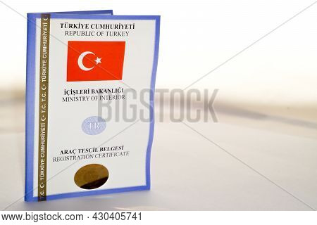 Car Key And Turkish Registration Licence On Isolated Background Close Up View