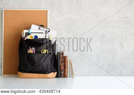 Backpack With Different School Stationary On White Table. Back To School Concept.