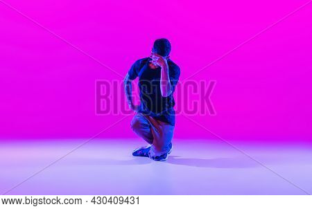 Modern Dance Style. Hip Hop, Break Dancing Dancer In Action, Motion In Dark Clothes Isolated Over Br