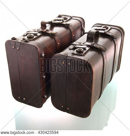 Two vintage suitcases isolated over white background