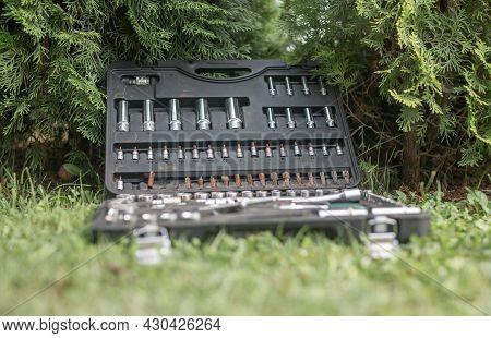 Metal Steel Repair Tools In Toolbox On Grass Outdoors.