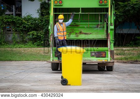 Worker Of Recycling Garbage Collector Truck Loading Waste And Trash Bin,waste Collectors At Work.