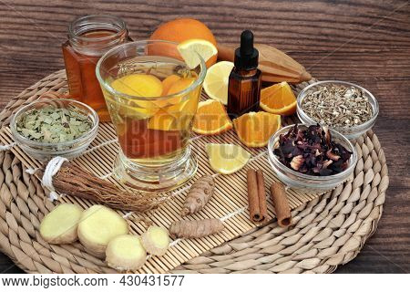 Medicinal remedy for cold, cough, flu and influenza with hot drink. High in antioxidants, vitamin c. Immune system boosting. Alternative natural health care treatment. On rustic wood.