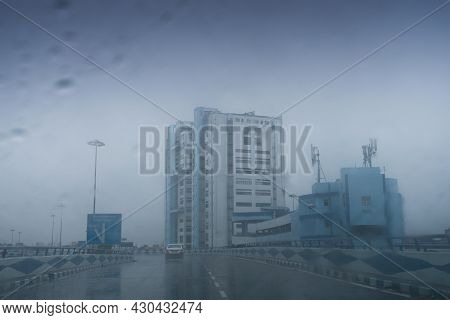 Raindrops Falling On Car Windshield Glass, Abstract Blurs Of Nabanna Building , State Administrative