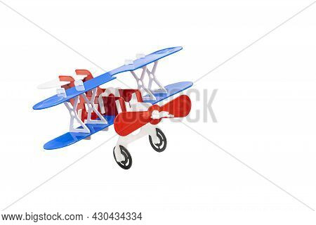 Colorful Model Antique Red Propeller Double Blue Wing Airplane Or Toy Biplane Made From Metal Sheet