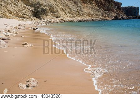 Beautiful Empty Beach In A Sunny Day. Blue Calm Waters, No People. Algarve, Portugal, Europe