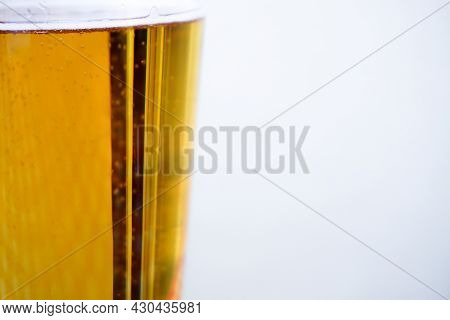 Fresh Beer With Bubbles In The Pint Close Up View