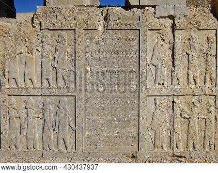 Reliefs Depicting The Persian Courtiers & Royal Servants, And Ancient Cuneiform (translates As