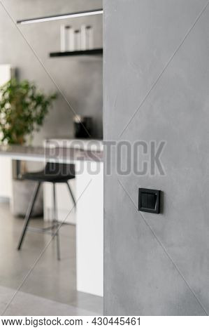 Modern Kitchen Interior With Simple Theme, Black Light Switch On Grey Wall, Various Furniture And Wh