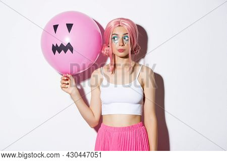Image Of Beautiful Glamour Girl In Pink Wig, Bright Makeup, Holding Balloon With Scary Halloween Fac