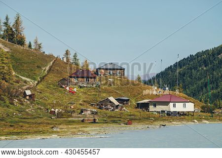 Weather Station On Hill Near Mountain Lake In Valley Among High Forest Mountains. Scenic Autumn Land