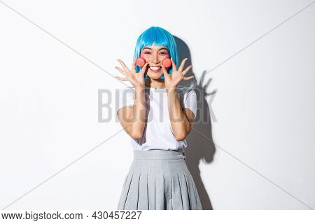 Image Of Beautiful Smiling Asian Girl Looking Silly, Showing Macaroons, Wearing Blue Anime Wig, Stan