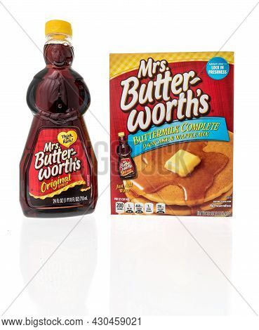 Winneconne, Wi -20 August 2021:  A Bottle Of Mrs Butterworths Syrup And Pancake Mix On An Isolated B