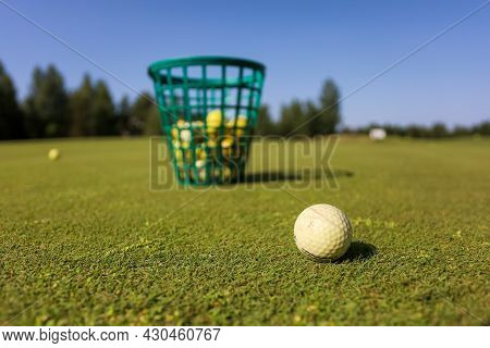 Basket Of Golf Balls On The Course.