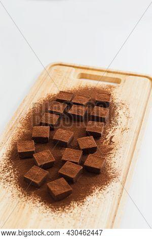 Fresh Nama Chocolate On Wooden Board In White Background Japaness Dessert.