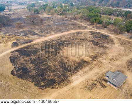 Aerial View Of The Burnt Land After Wildfire In Northern Region Of Thailand. Wildfires Can Occur Nat