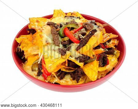 Bowl Of Beef And Cheese Nachos With Red And Green Peppers Isolated On A White Background