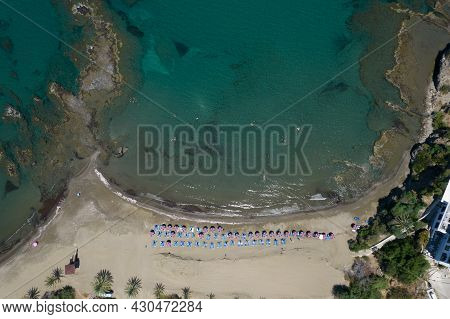 Tropical Swimming Sandy Beach With Crystal Clear Water And Colorful Umbrellas On The Coast. Omega Co