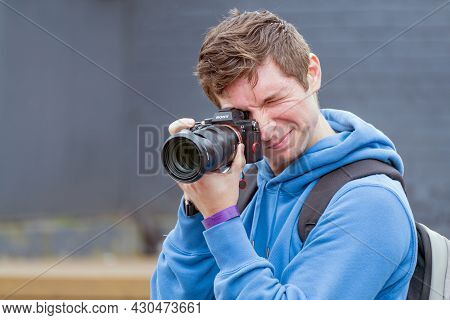 Moscow. Russia. August 13, 2021 Photographer Holds A Samera In His Hands. Reportage Photography.