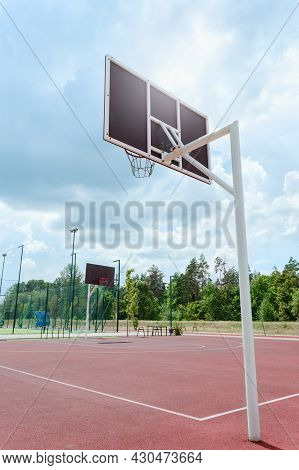 Public Basketball Court Outdoor. Vertical View. Low Angle View