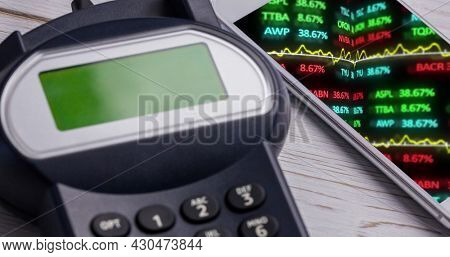 Image of financial data processing on smartphone next to payment terminal. global finances, business and contactless payment concept digitally generated image.