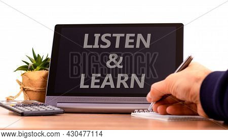 Listen And Learn Symbol. Tablet With Words 'listen And Learn'. Businessman Hand With Pen, House Plan