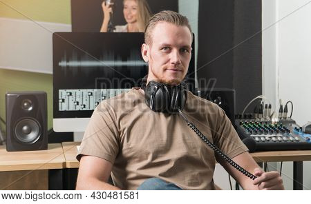 Caucasian Young Man Smiling Look At Camera With Headphone Sound Engineer Mixer Audio  In Studio Reco
