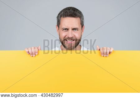 Happy Man With Copy Space For Advertisement. Guy Advertising. Announcement.