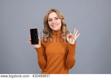 Approved Mobile Phone. Happy Girl Show Ok Sign To Smartphone. Approved Concept