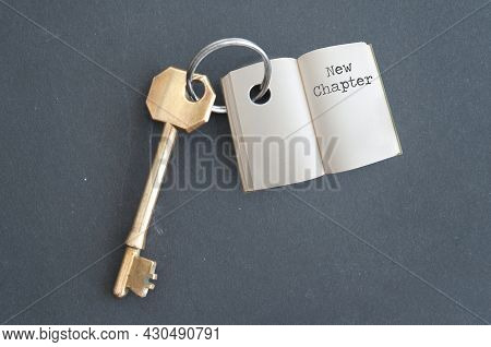 Keyring With Open Book And Chapter One On A Chalkboard