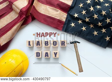 Happy Labor Day Printed On Wooden Blocks With Vintage American Flag And Work Tools