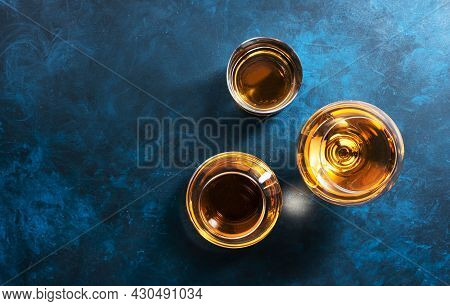 Strong Alcohol Drinks, Hard Liquors, Spirits And Distillates Iset In Glasses: Cognac, Scotch, Whiske