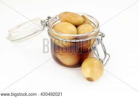 Glass Storage Jar Filled With Pickled Cooked Shelled Cockle Shellfish Meat Isolated On A White Backg