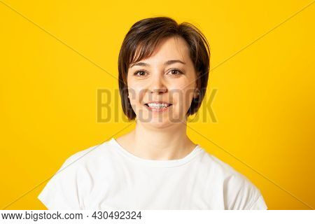Happy Woman With Toothy Smile, Wears Casual Solid White T Shirt, Expresses Good Emotions, Enjoys Nic