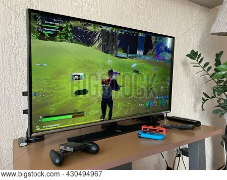 10.04.2021 Cyprus Paphos Tv Set With Fortnite Computer Game On Screen In The Home During Quarantine