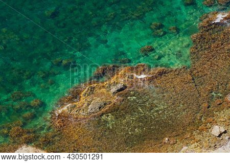 The Texture Is Ocean Stones. Turquoise Sea Water Aerial View. Natural Tropical Background For Summer