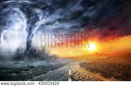 Tornado In Stormy Landscape - Climate Change And Natural Disaster Concept