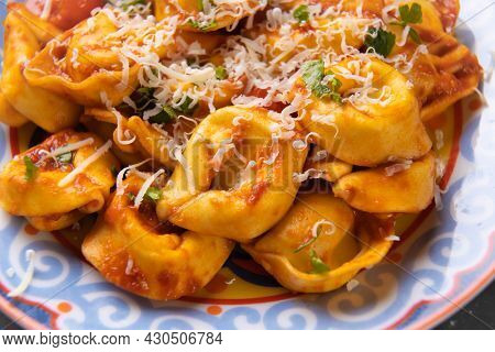 Classic italian tortellini cheese filled pasta in tomato sauce