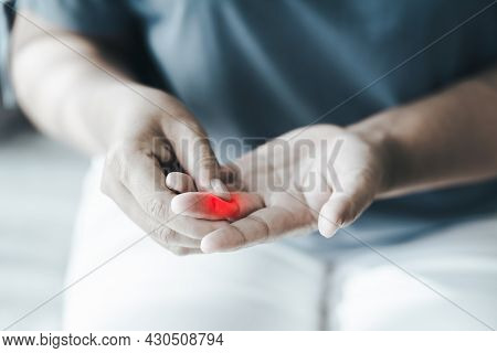 Woman Suffering From Hand And Finger Joint Pain With Red Highlight. Causes Of Rheumatoid Arthritis
