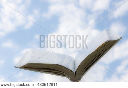 Blank White Open Book On Sky Background